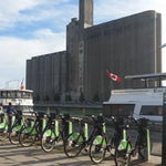 When you come out the tunnel walk along the water past the abandoned grain silos and pick up a city bike $7 for the day and 15 min ride to downtown