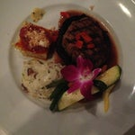 Photo taken at Gratzzi Italian Grille by Amber T. on 6/23/2013