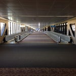 Got an hour to kill? Stretch your legs with a wander around the rectangle of terminals. Infinite walkways! Wacky carpet! Note it's not a full loop. You can only cross n/s from b to c at the east end.