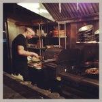 Photo taken at Barbuzzo Mediterranean Kitchen & Bar by Jon F. on 5/26/2013