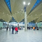 New terminal has a modern spacious design with high ceilings and nice illumination. Free wifi is provided and works fast. There are plenty of shops including cafes, gift shops, pharmacy and Starbucks!