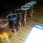 Photo taken at Rock Bottom Restaurant & Brewery by Tyler M. on 6/30/2013
