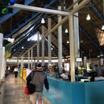 Most charming airport in the world. The Roof is made of palm. There are always little live bands playing.