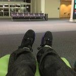 Nice comfortable chairs on upper level where you check in. They recline and there's also a separate foot rest. Best place to do an overnight layover and be comfortable.
