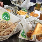 Photo taken at Wahlburgers by Marcia B. on 6/24/2012