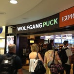 Photo taken at Wolfgang Puck Express by Edwin K. on 7/13/2013