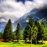 Photo taken at Bohinjsko jezero (Bohinj Lake) by Kate M. on 7/16/2013
