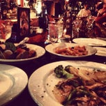 Photo taken at 7 Old Fulton Restaurant and Wine Bar by Evan D. on 1/1/2013