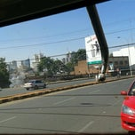 Photo taken at Globe Cinema Roundabout Bus Station by Chrispine S. on 2/19/2013