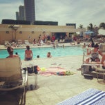 Photo taken at Hilton Hotel Rooftop Pool by Chris B. on 3/15/2013