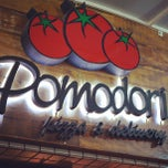 Photo taken at Pomodori Pizza by Camila R. on 6/3/2013