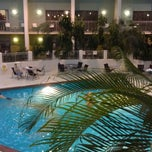 Photo taken at Ramada Oasis Hotel & Convention Center by Chad L. on 2/16/2013