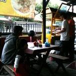 Photo taken at Bubur Ayam Syarifah Jakal by Fitra D. on 8/16/2013