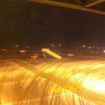 Photo taken at Gate D12 by Nesat O. on 2/11/2013