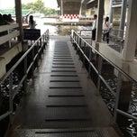 Photo taken at ท่าเรือสะพานตากสิน (Tak Sin Pier) by Teh K. on 4/18/2013