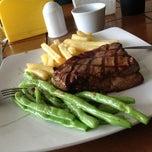 Photo taken at Me'nate Steak House by Zain B. on 2/2/2013