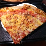 Photo taken at Gino & Joe's Famous NY Pizza by Julie L. on 1/24/2014