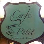 Photo taken at Café Petit by Sae K. on 12/31/2012