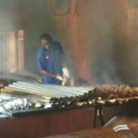 Photo taken at Scotchies Jerk Centre by Christopher H. on 5/16/2011