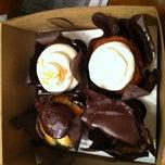 Photo taken at Indulge Cupcake Boutique by Kurt S. on 7/15/2012