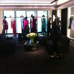 Photo taken at Yves Saint Laurent by Ksenia on 4/13/2012