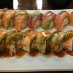 Photo taken at Sushi Moto by Elisa M. on 6/6/2013
