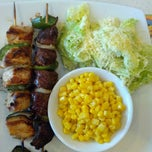 Photo taken at Pollo Tropical by Carlos M. on 3/17/2013
