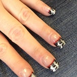 Photo taken at Cuticles Nail Salon by Cleo L. on 11/23/2012