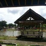 Photo taken at Danau perum Alamanda regency by Dyah N. on 3/22/2014
