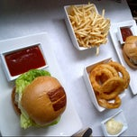 Photo taken at Umami Burger by Patrick W. on 12/1/2012