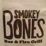 Photo taken at Smokey Bones Bar & Fire Grill by Elizabeth C. on 3/7/2013