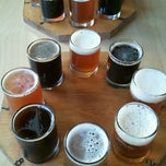 Photo taken at Gilded Otter Brewing Company by Susan F. on 9/16/2012