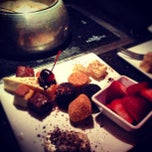 Photo taken at The Melting Pot by Ben K. on 7/14/2013