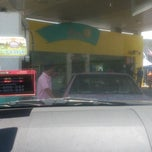 Photo taken at Petronas by CiK S. on 9/23/2013