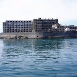 Photo taken at 端島 (軍艦島) Hashima (Gunkanjima) Island by Taben N. on 10/27/2012