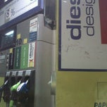 Photo taken at Gasolinera Carrefour Planet by Veronica C. on 11/5/2012