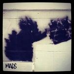Photo taken at Banksy Mural: 'Glitter Glasses' Rat by Paul B. on 5/21/2012