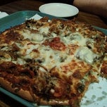 Photo taken at Red's Savoy Pizza by Robert G. on 3/21/2013