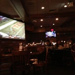 Photo taken at Champps Americana by Miles S. on 12/30/2012