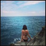 Photo taken at Spiaggia Libera Caranca - Sant'Ampelio by Maria K. on 8/25/2013