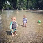 Photo taken at Volunteer Park Wading Pool by Kamel P. on 7/4/2014