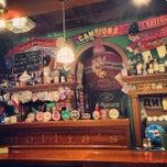 Photo taken at Mollie's Irish Pub by Tati G. on 2/10/2013