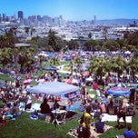 Photo taken at Mission Dolores Park by Ryan C. on 6/29/2013