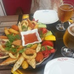 Photo taken at Alinda Cafe & Bar by Derya S on 10/28/2012