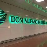 Photo taken at Don Mueang International Airport (DMK) ท่าอากาศยานดอนเมือง by ukitkai k. on 7/19/2013