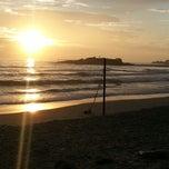Photo taken at Praia de Itapoá by Alfabile S. on 1/1/2013
