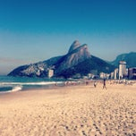 Photo taken at Praia de Ipanema by Daniel V. on 7/14/2013