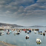 Photo taken at Lyme Regis by Anna S. on 4/5/2015