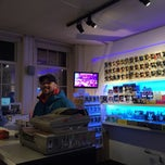 Photo taken at Outland Designer Toy Store & Art Gallery by Laura C. on 1/1/2015