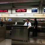 Photo taken at United International Check In by Moises B. on 2/15/2013